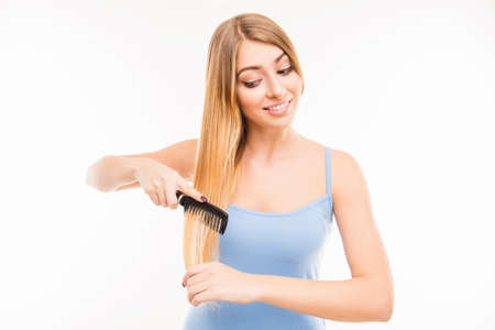 combing: Pretty cute girl combing her hair