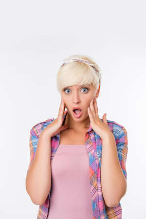 suddenness: beautiful young woman with short hair is surprised