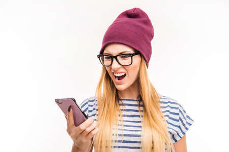furor: Shocked frustrated young woman with phone