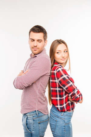 he she: Young couple in love  standing back to back with crossed hands Stock Photo