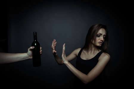 bad habits: The social problem. Young unhappy woman, rejection of bad habits Stock Photo