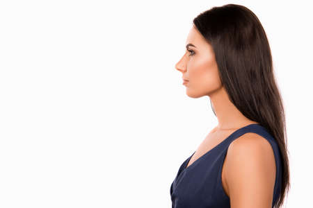 minded: Side view photo of serious minded businesswoman in dark blue dress