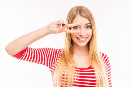 fingers: Cheerful girl gesturing with two fingers near eyes Stock Photo