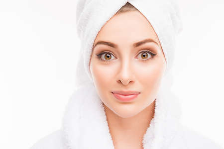 female in douche: Young cute girl with towel on her head after shower