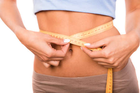 enteric: Close up photo of girl measuring the waist with a measuring tape