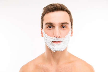 fullface: A full-face portrait of young man with shaving cream in bathroom Stock Photo