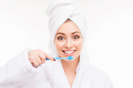 dental health: Young cute girl with towel on her head holding toothbrush
