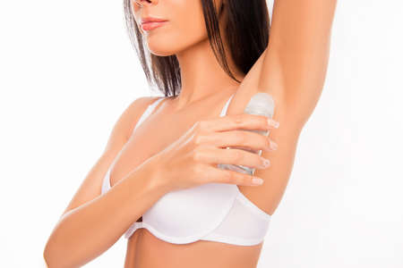 deodorant: Close up photo of healthy young woman  using deodorant. Stock Photo