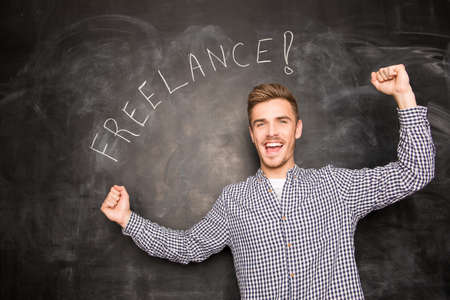 achieved: successful young freelancer has achieved the goals against the background of chalkboard Stock Photo