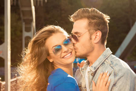 express positivity: Romantic couple in love on the bridge with glasses