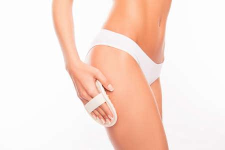 exfoliation: Closeup photo of young woman making spa exfoliation Stock Photo