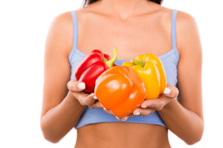belly pepper: Closeup photo of sexy woman holding colored peppers