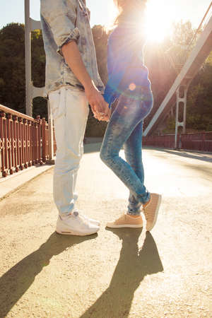 foot bridges: Cheerful nice couple in love on the bridge standing together