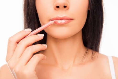 maquillage: Young woman doing maquillage with lips liner, close up photo