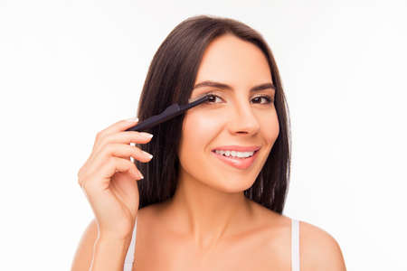 brash: Portrait of cute girl doing maquillage with brash of mascara Stock Photo