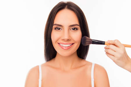 maquillage: Portrait of cute cheerful girl doing maquillage with brush of powder Stock Photo
