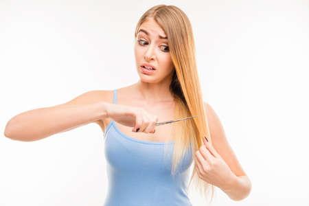 split ends: Pretty woman cutting her split ends