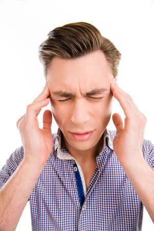 spite: Handsome man touching his head suffering from headache, close up photo