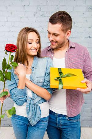congratulating: Close up photo of smiling man congratulating his wife