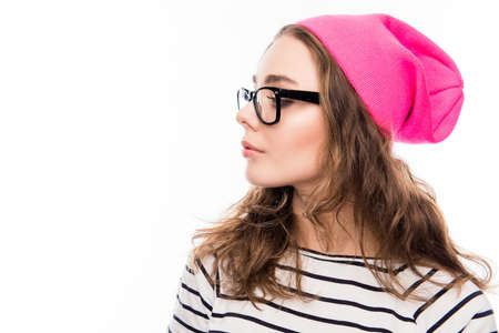pink hat: Side view portrait of cute girl in pink hat and glasses Stock Photo