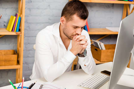way of thinking: Serious minded man thinking about way to solve his problems