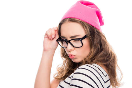 pouting: Cool girl in glasses and pink hat pouting and winking