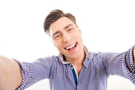 cadre: Attractive cheerful happy young  man making selfie Stock Photo