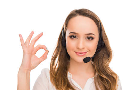 caller: Cheerful young  agent of call centre gesturing OK