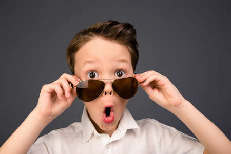 surprised kid: Portrait of little surprised kid in glasses with open mouth