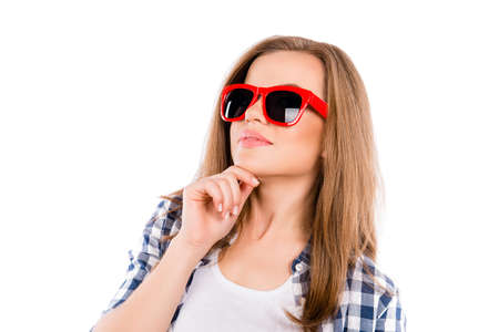minded: Portrait of pretty minded woman in red glasses touching chin Stock Photo