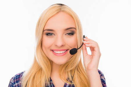 caller: Portrait of happy young smiling agent of call center Stock Photo