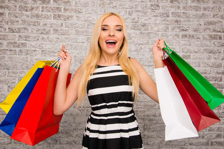 happy shopper: Pretty happy shopper demonstrating her new purchases