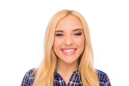 beaming: Close up portrait of pretty toothy girl with beaming smile Stock Photo