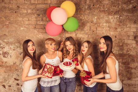 surprise party: Smiling girls with happy expressions on their faces Stock Photo