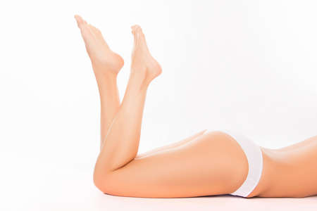 shapely legs: Close up photo of  smooth womans legs and shapely buttocks Stock Photo