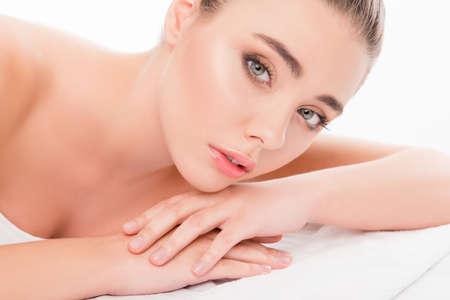 sauna nackt: Close up portrait of beautiful sensetive woman lying in sauna