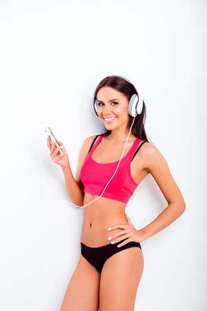 sexy headphones: Sexy girl  listening music with white headphones