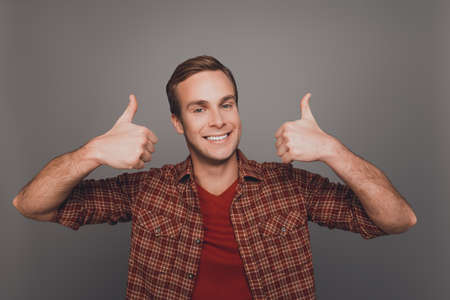 beaming: Cheerful man with beaming smile showing thumbs up Stock Photo