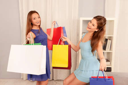 lesbo: Happy pretty sisters showing shopping packs with purchases Stock Photo