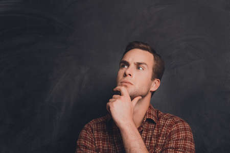 to ponder: Portrait of ponder man on the background of chalkboard Stock Photo