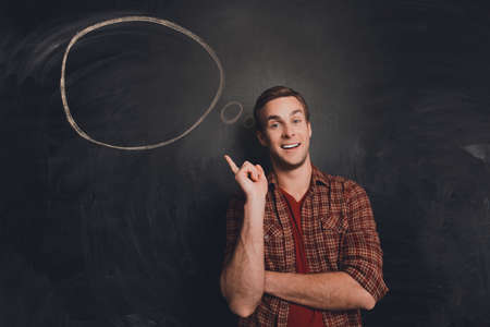 express positivity: Handsome happy young man thinking about solving problem Stock Photo