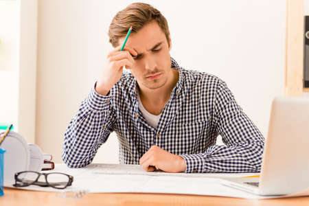 way of thinking: Serious tired architect thinking about way to end plan