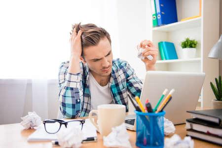 bad mood: Portrait of depressed man in bad mood failing task Stock Photo