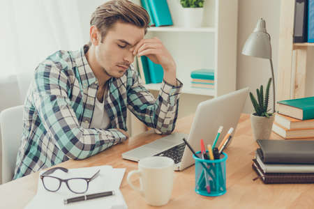 Overworked sick man in bad mood thinking about task