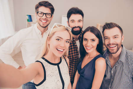 happy young successful group of businesspeople   make selfie photo and smiling Stock Photo - 59056380