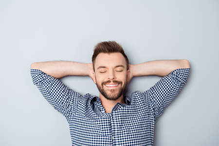 long day: Handsome relaxed man with closed eyes resting after long day