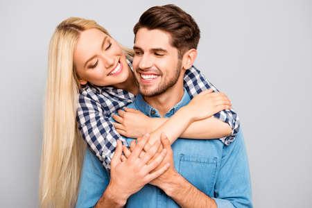 he: Cute young woman embracing her boyfriend, he carrying her