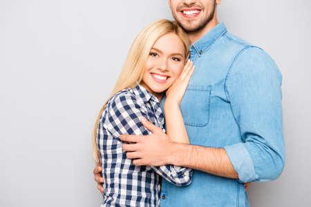 cute girlfriends: close up photo of man hugs his cute blonde girlfriends Stock Photo