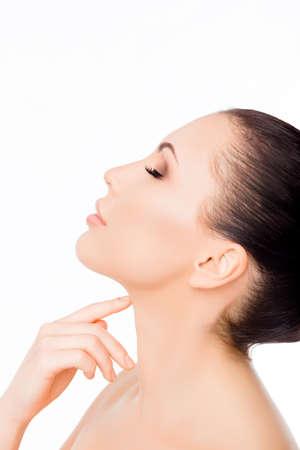 sensitive: Side view portrait of beautiful sensitive woman touching her neck