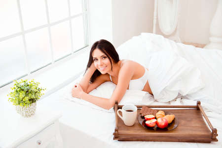 breackfast: Cute happy sexy girl wake up with wooden tray with tasty breackfast Stock Photo